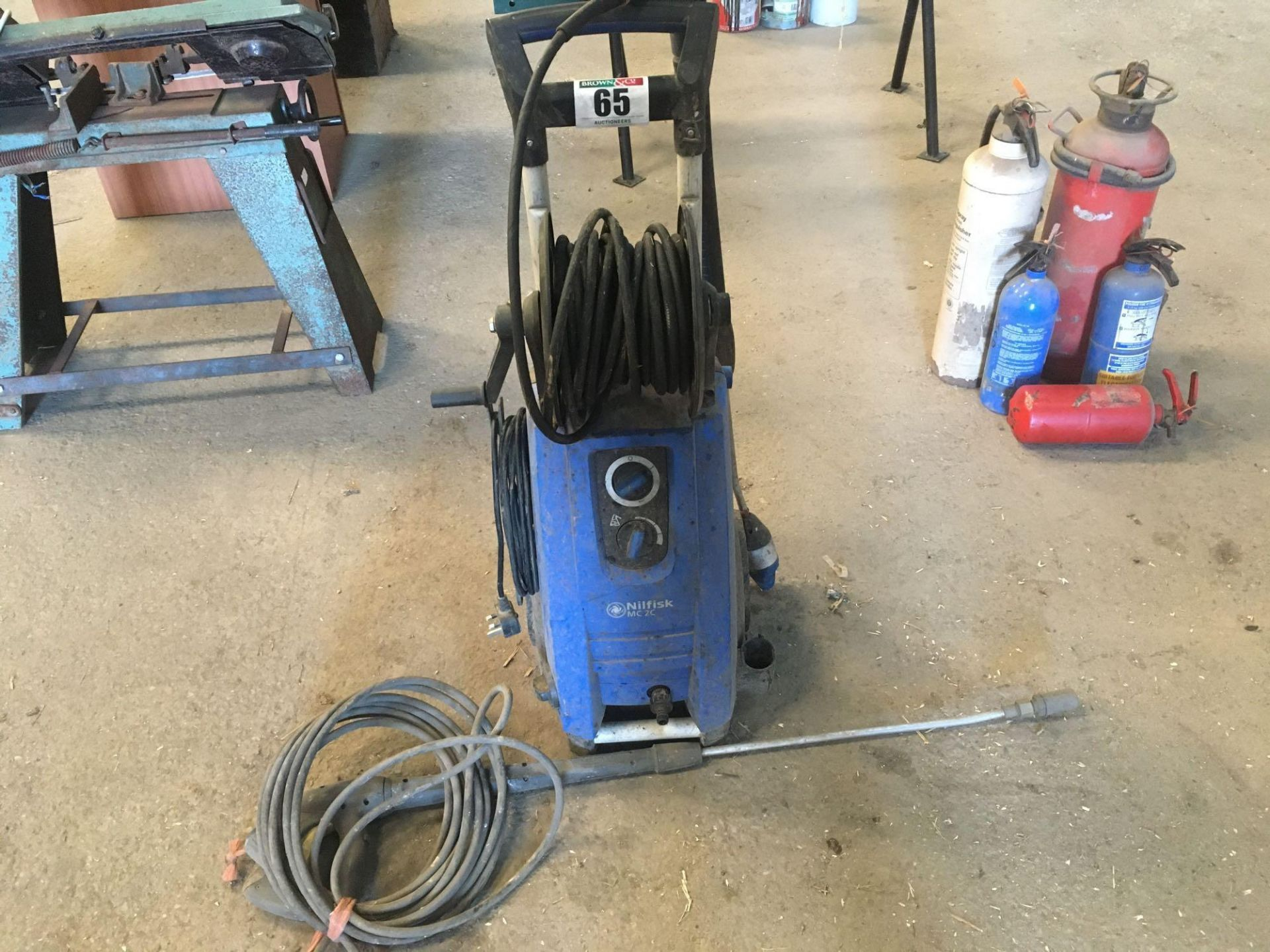 Pressure washer. Manual in office.