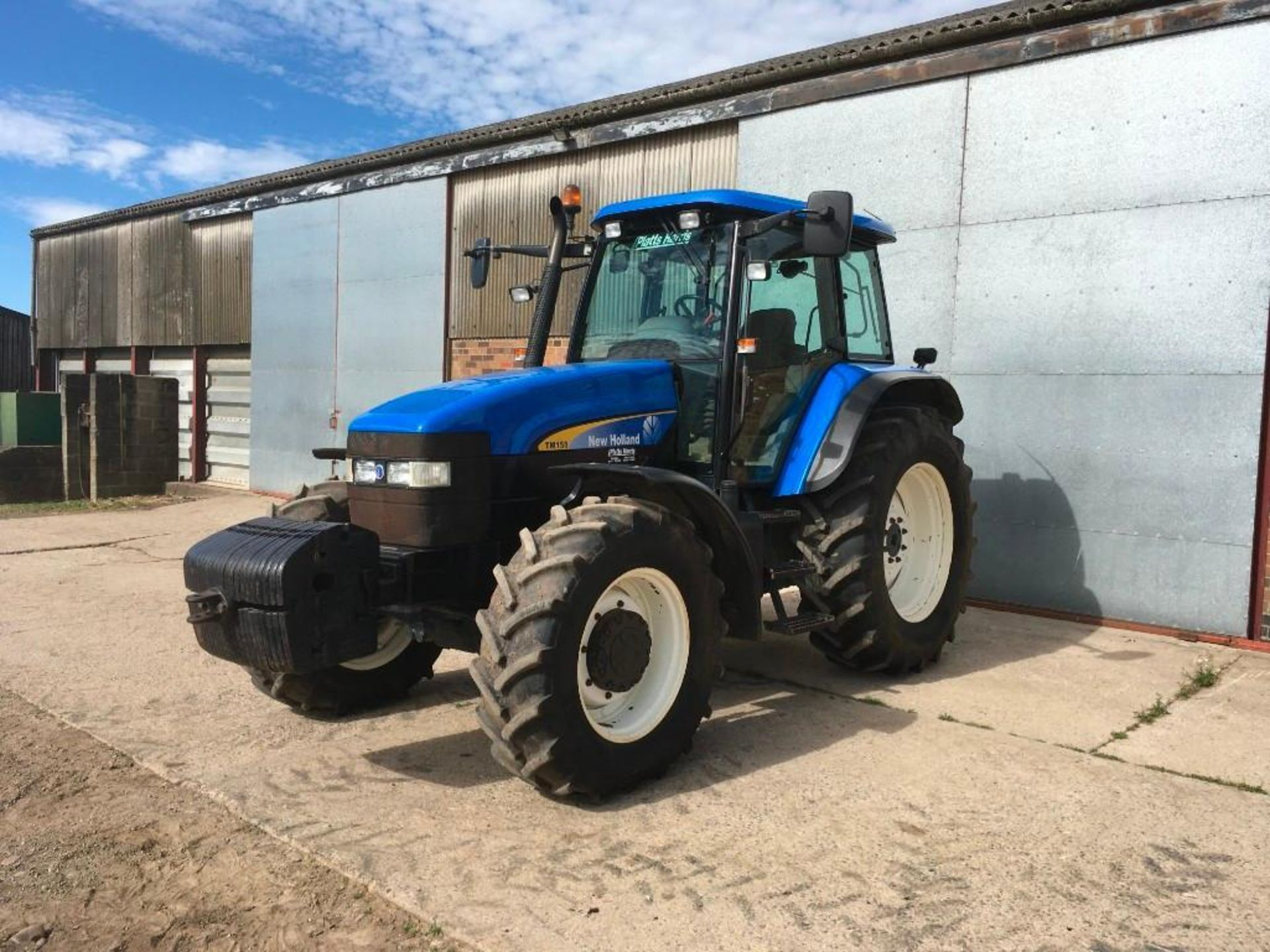 2007 New Holland TM155 tractor with range command gear box, 4 spool valves, push out pick up hitch,