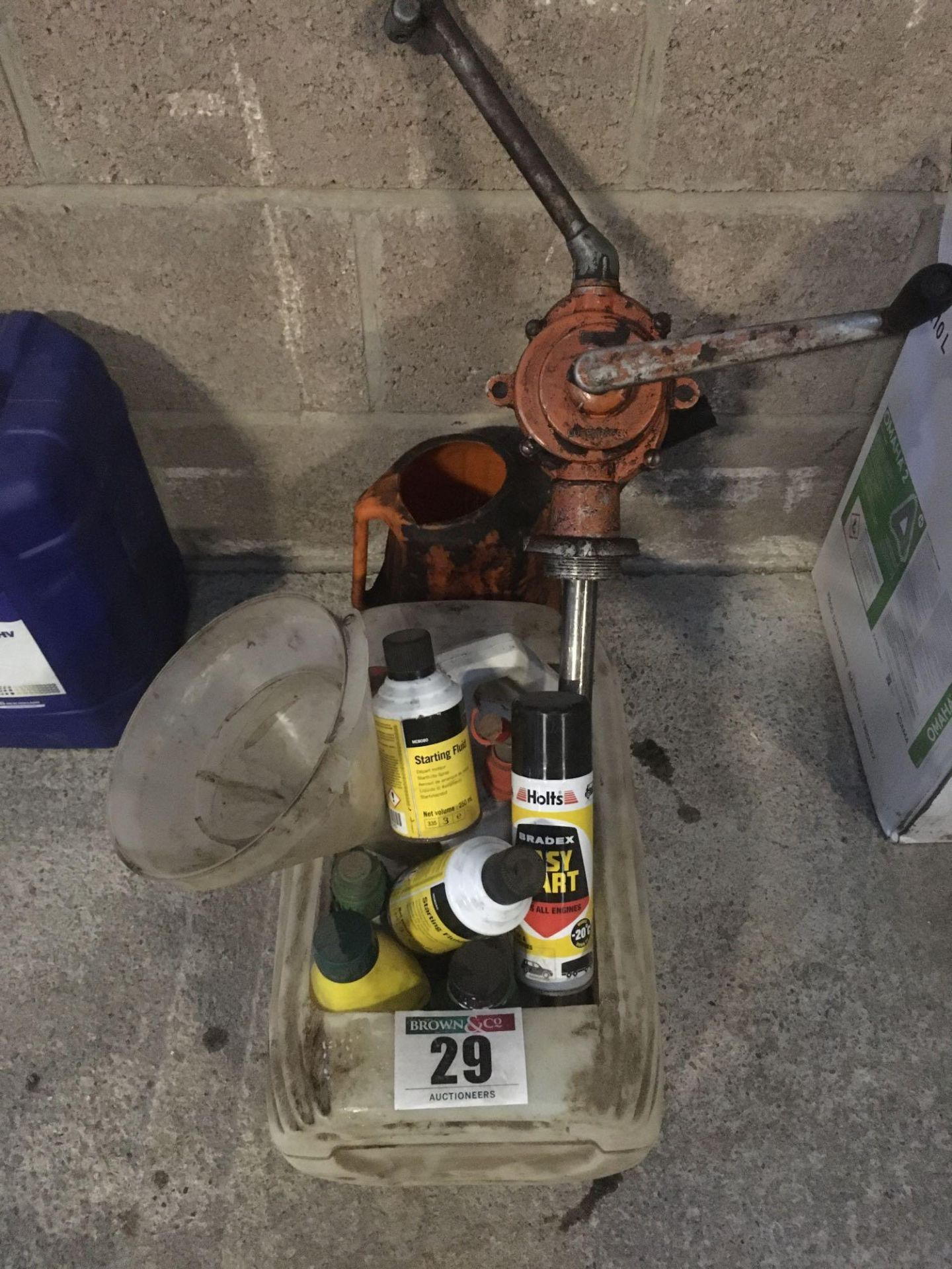 Assorted oils, starting fluid, oil pumps and funnels etc