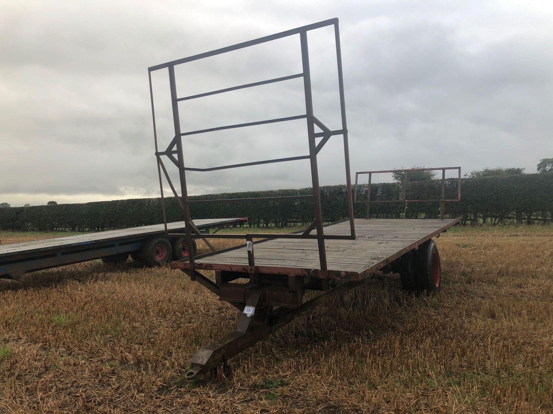 Homemade single axle 20ft flatbed trailer. C/w front and rear raves