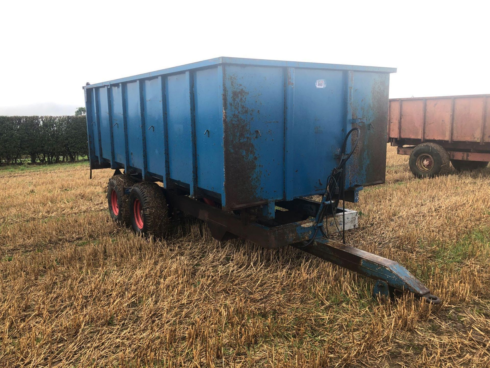 8t twin axle trailer with manual rear door and grain chute. C/w silage sides. On 12.5/80-15.3 wheels