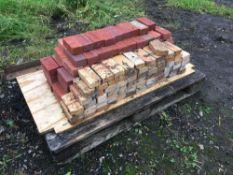 Quantity decorative bricks, pallet in the yard