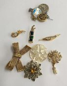 Mixed lot of brooches and badges to include a mother of pearl Bethlehem brooch, a brooch in the form