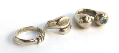 Three silver rings, gross weight 38g