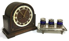 A Mantel clock, plaque to reverse reading W. Pellant & Son, Harpenden; together with a plated