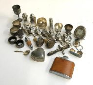 A mixed lot of plated, white metal, and silver items, to include cactus napkin rings; Mapp & Webb