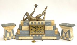 A marble Art Deco French mantel clock, including key pendulum and two garnitures