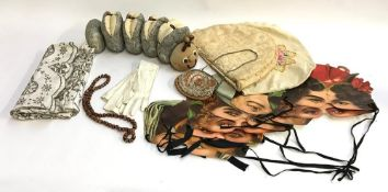 A mixed lot to include a Liberty caterpillar; beaded velvet purse; party game masks; kid gloves; tea