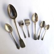 A small lot of silver comprising a George III teaspoon and desert spoon, a later teaspoon, etc,