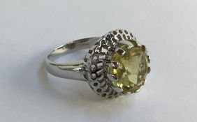 9ct white gold ring set with a lemon citrine, gross weight 6.2g, size N