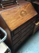A mid-18th century mahogany and marquetry bureau, fall front above four graduating drawers, on