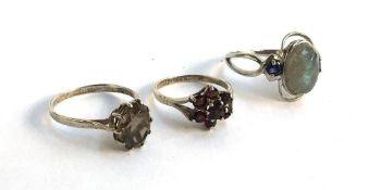 Three silver dress rings