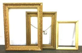 Three giltwood frames, the smallest 42x31, one with wheat sheath molding, 43x53cm, the largest