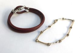 Leather and silver bracelet plus further silver bracelet set with small white stones