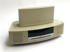 A Bose Wave CD player; together with a Bose Wave DAB module