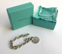 Tiffany & Co silver round link bracelet with Tiffany & Co charm, gross weight 37.2g. In original