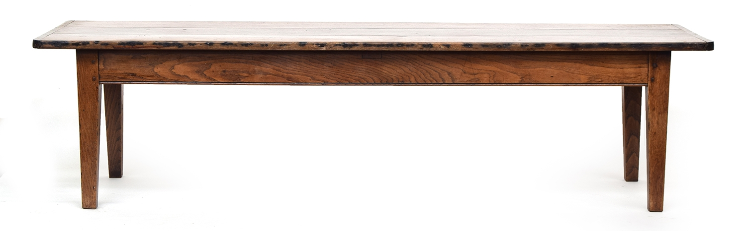 A 19th century low oak table, three plank top with cleated ends, on square tapered legs, 200cm wide,