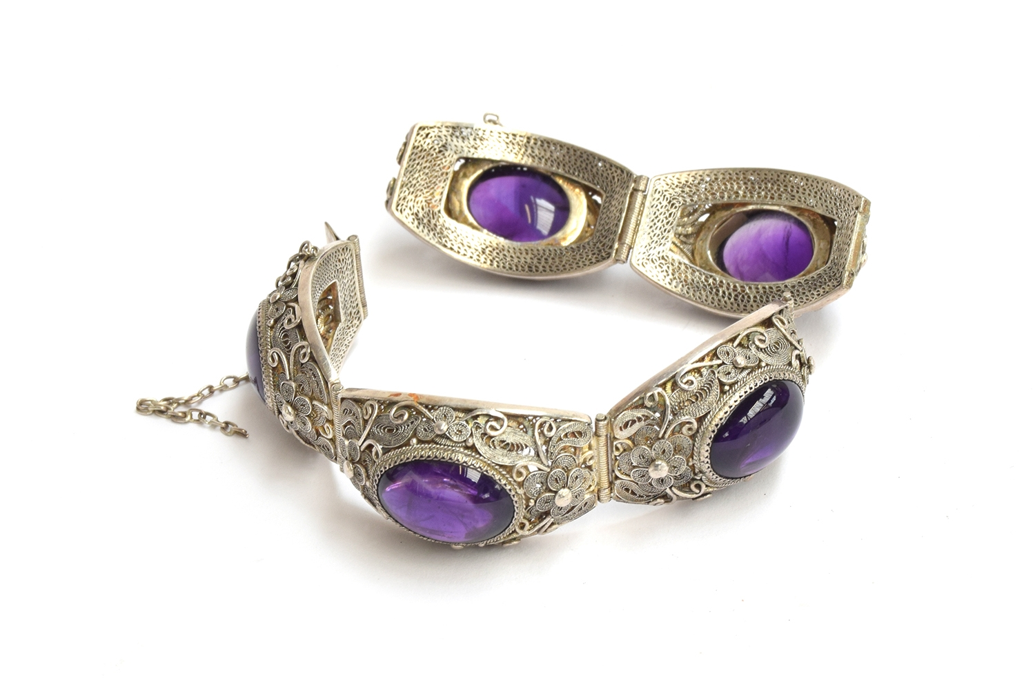 A Chinese silver filigree bracelet set with 5 amythyst cabochons (in two pieces)