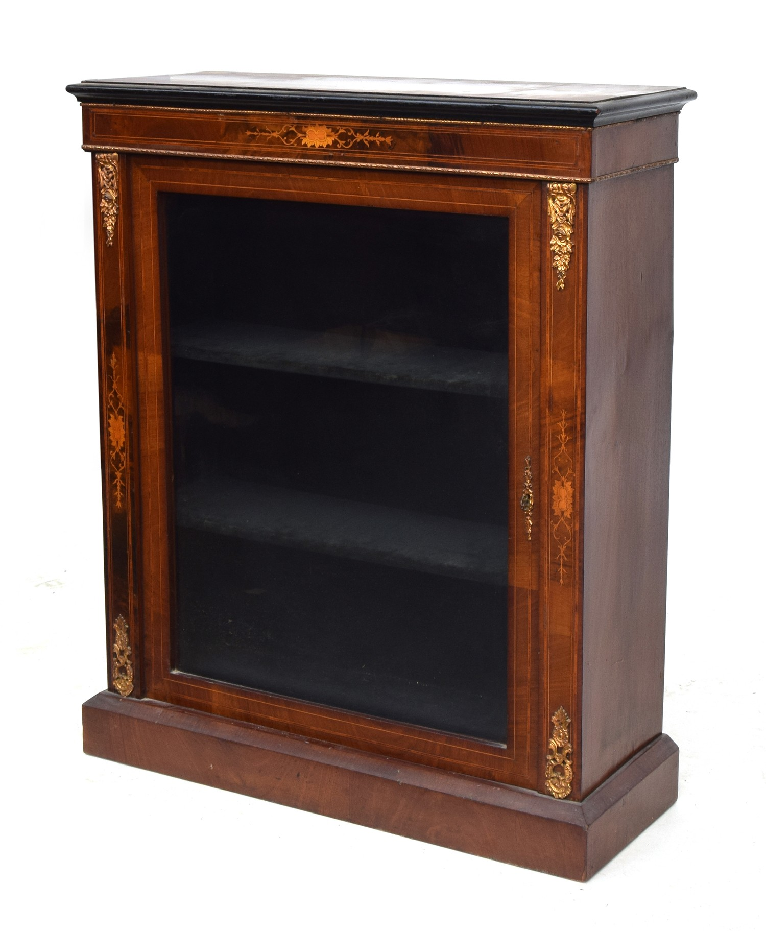 A small mahogany, marquetry and ormolu mounted glazed bookcase, the door opening to a baize lined