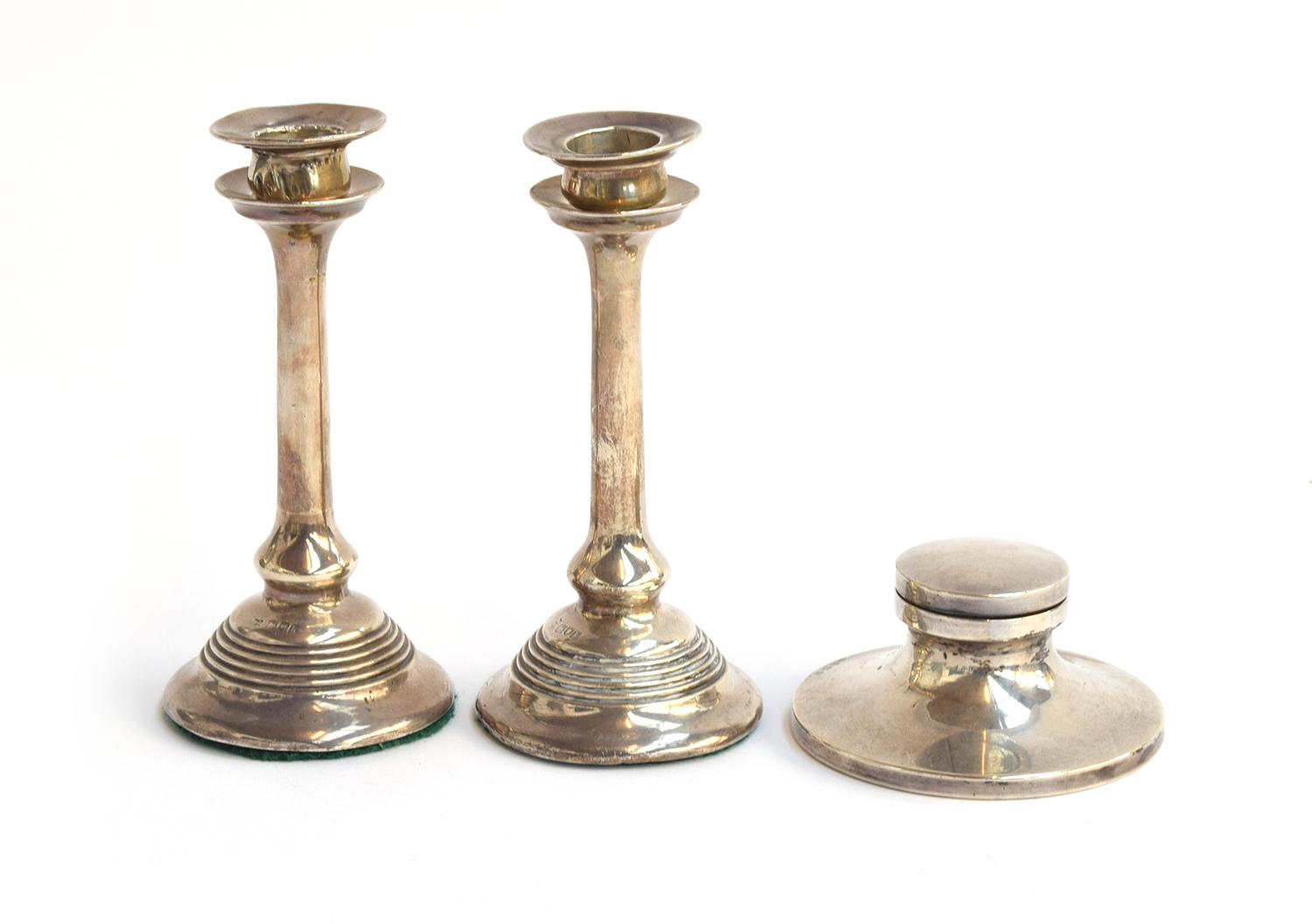 A small pair of silver candesticks with removeable bobeches, by Josiah Williams & Co, London 1905,