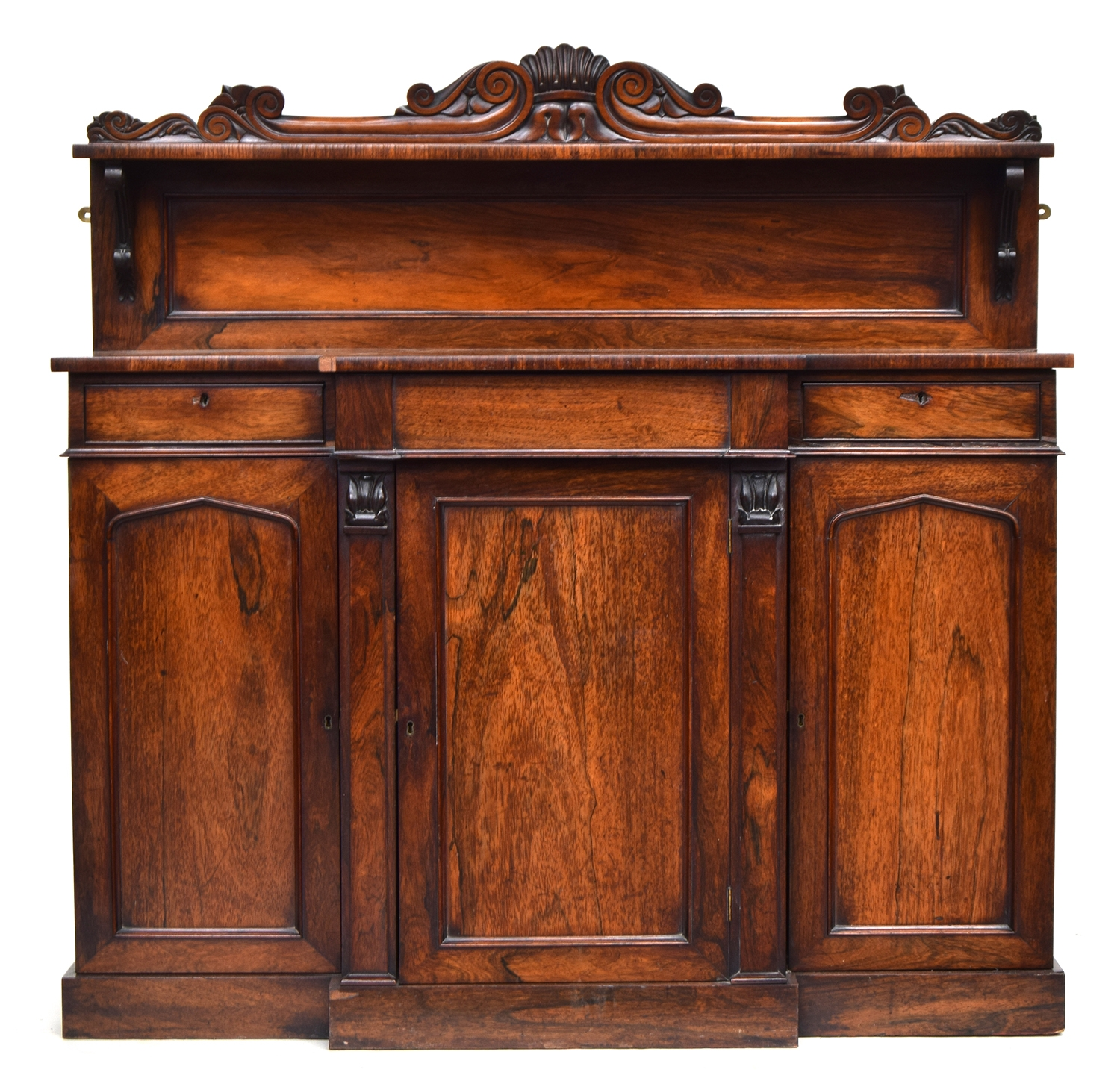 A 19th century break front rosewood chiffonier, carved upstand with single shelf, central fitted