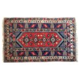 An Oriental wool rug, 150x237cm