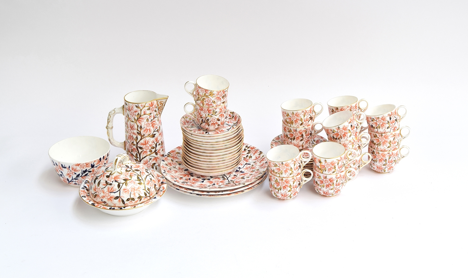 A Royal Crown Derby part tea service, floral Imari pattern heightened in gilt, marked '374' to base,