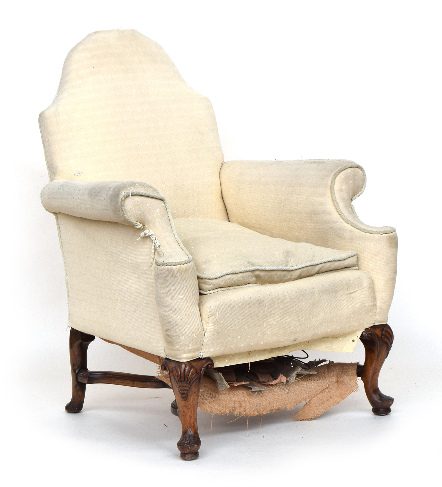 A good 19th century armchair, domed back with outward scrolling arms, on shell capped cabriole legs,
