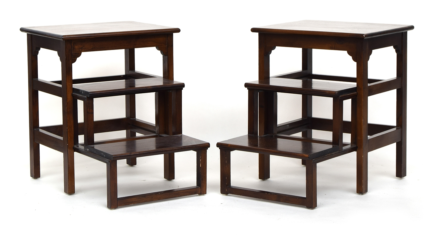 A pair of contemporary metamorphic library steps/occasional tables, the lower two steps with sliding