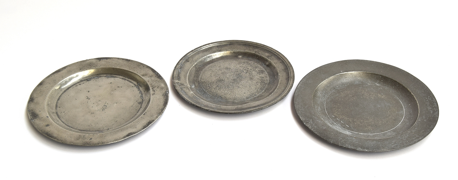 Three 19th century pewter plates, one by Allen Bright, 21cm diameter; the two others marked