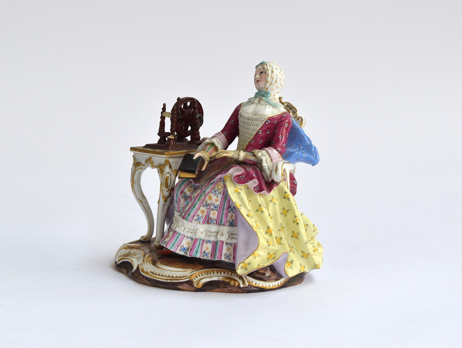 A 19th century Meissen group of a seated lady at a spinning wheel, 'The Good Housekeeper' or ' - Image 2 of 3