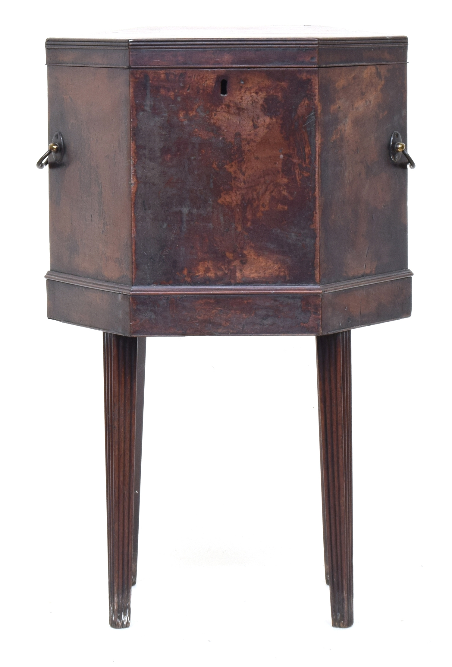 A George III mahogany hexagonal cellarette, twin brass handles, on moulded tapered legs