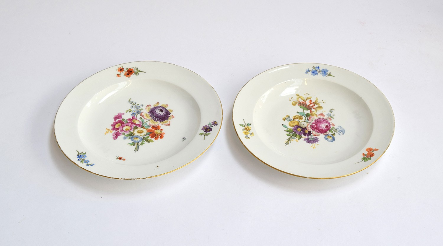 Four late 18th century Meissen hand painted floral plates, blue crossed sword marks to base, rim - Image 2 of 2