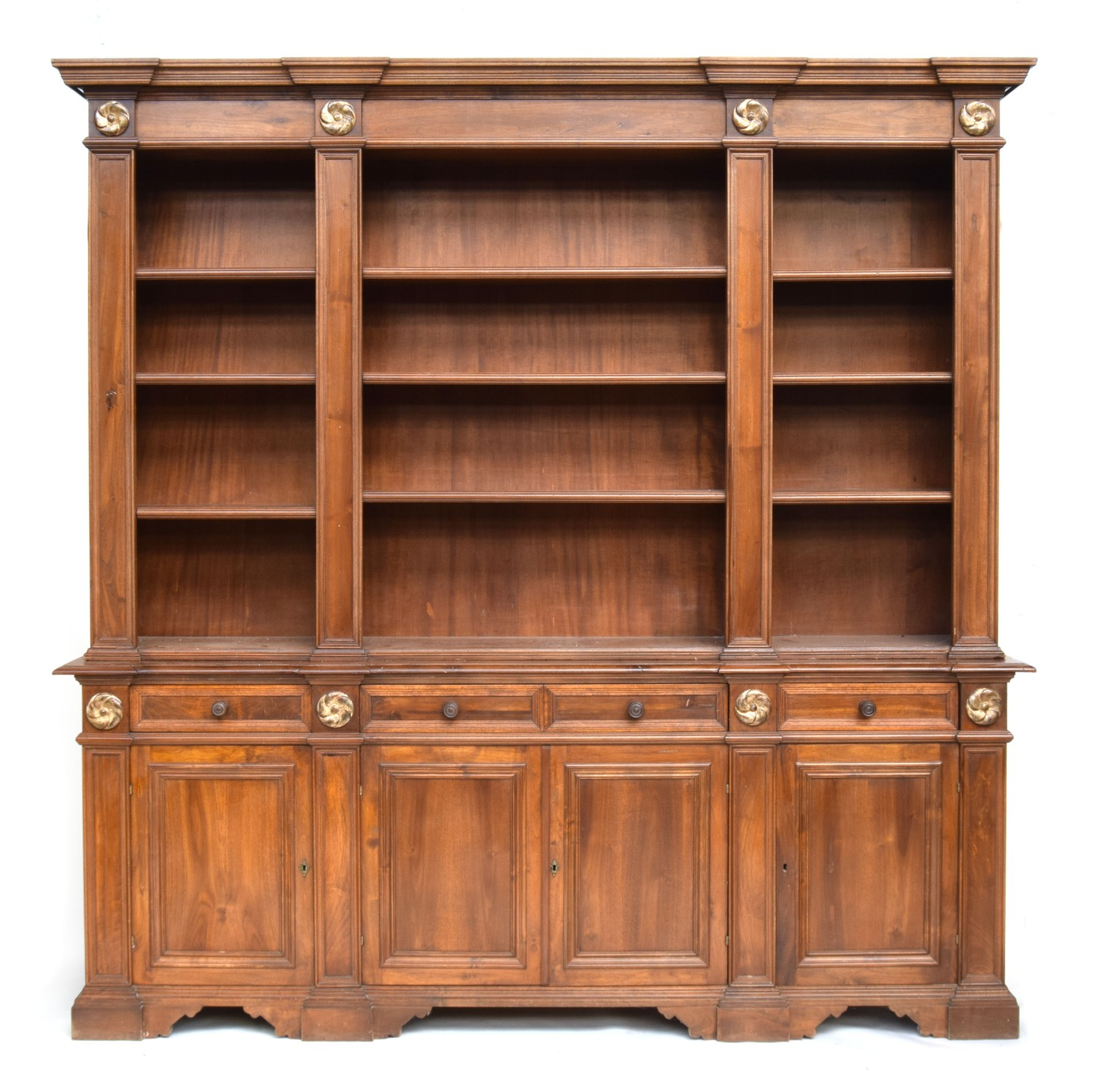 A substantial mahogany bookshelf, with three sections of adjustable shelves, applied gilt roundels