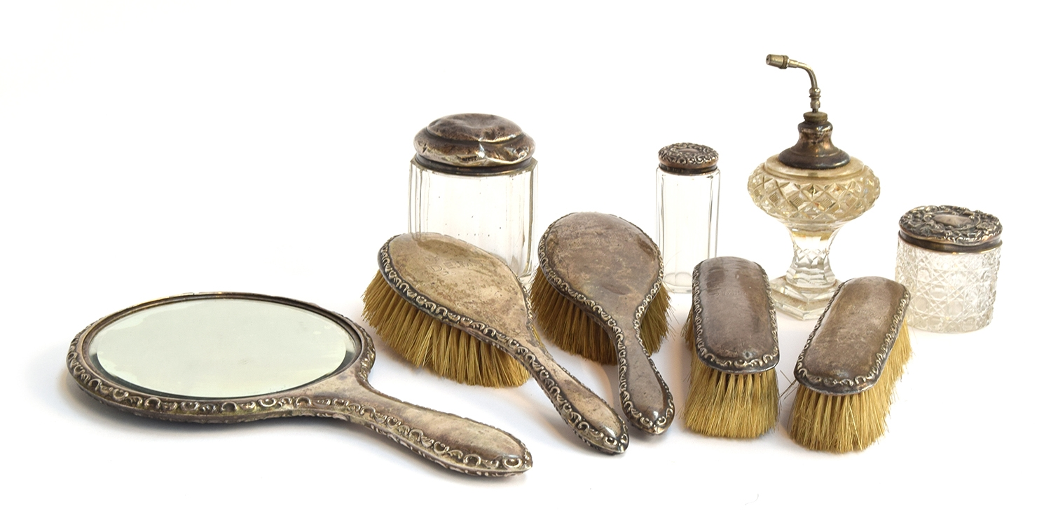 A silver dressing table set, several makers and years, including William Aitken, and A G Sheppard