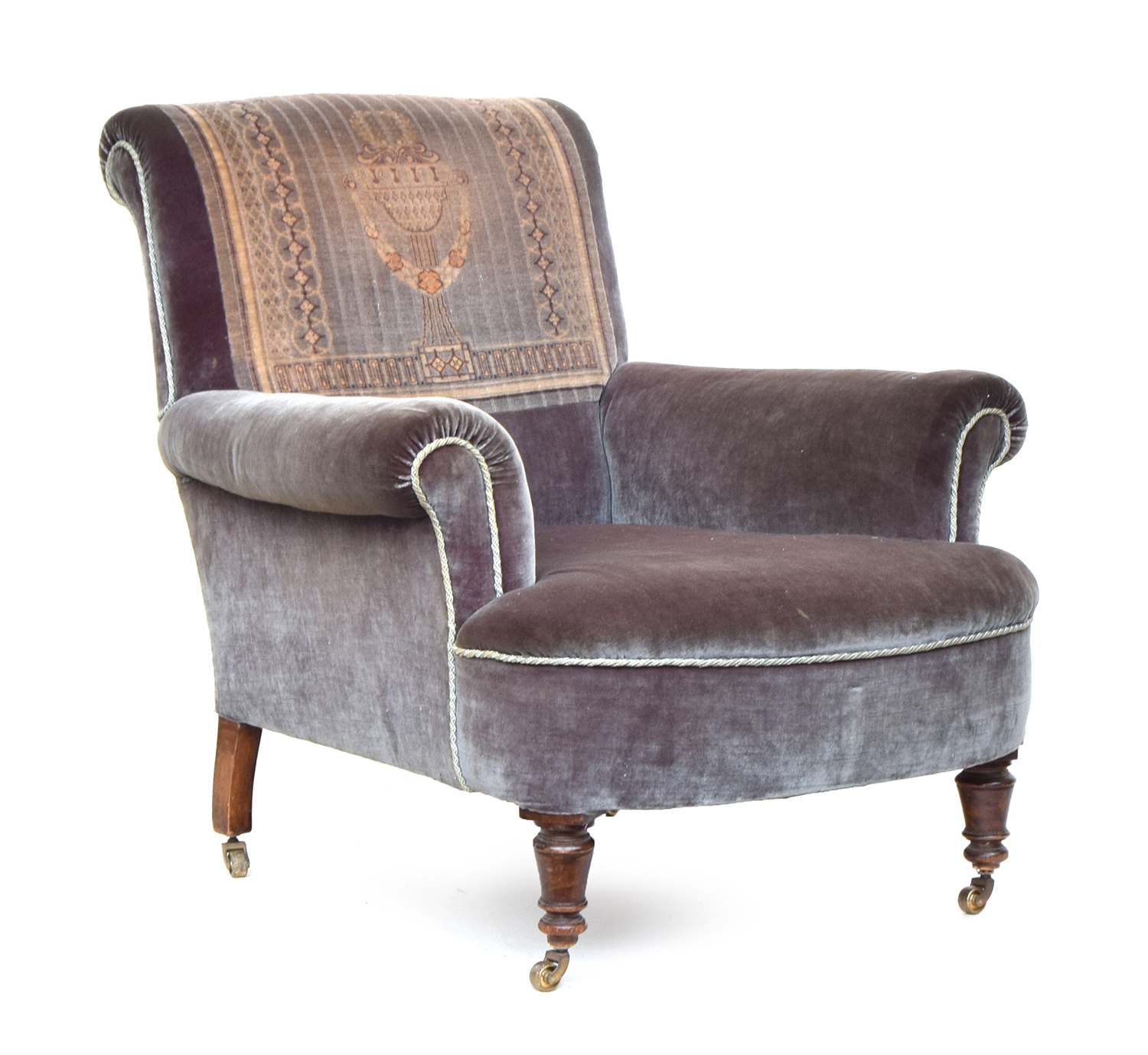 A 19th century armchair, woven carpet panel, with outswept arms on turned casters