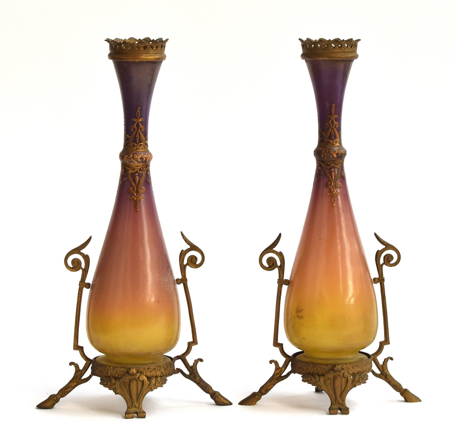 A pair of Jugendstil glass and brass vases, purple and ochre graduating glass, with scrolling enamel
