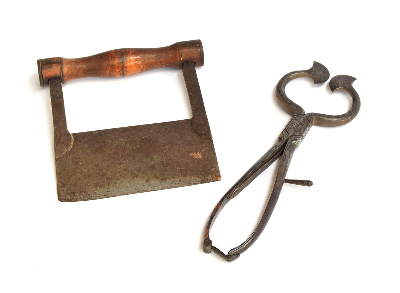 A 19th century steel sugar loaf cutter, made by W&C Wynn, 26cm long; together with a dough cutter,
