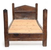 A 17th century oak bed frame, 112cm wide, approximately 200cm long, the headboard 110cm high