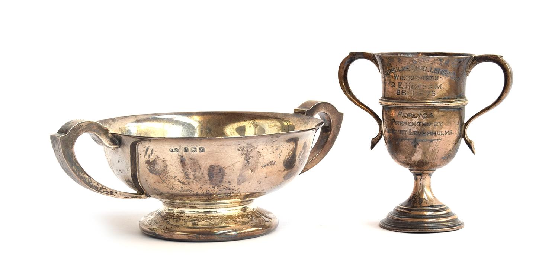 A twin handled silver pedestal bowl by Finnegan's Ltd, Birmingham 1923, 13.5cm diameter; together
