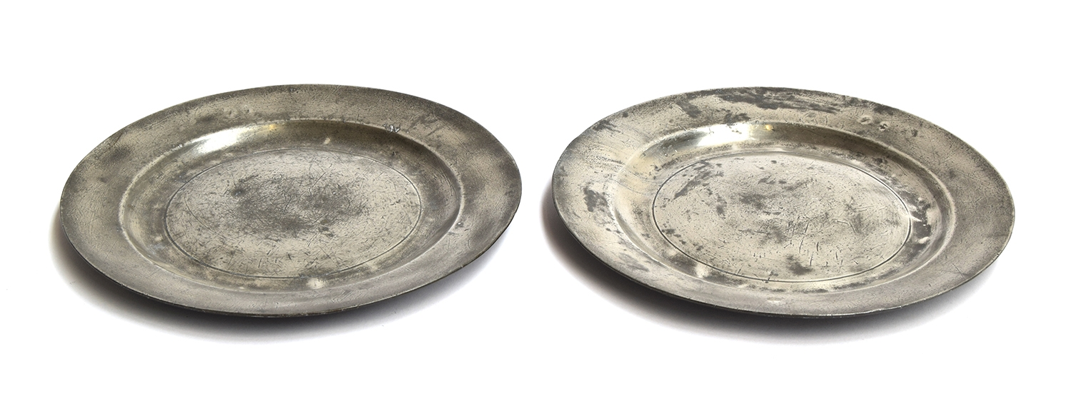 A pair of 19th century pewter plates, each stamped with maker's mark 'SC' and 'LONDON', 22.5cm