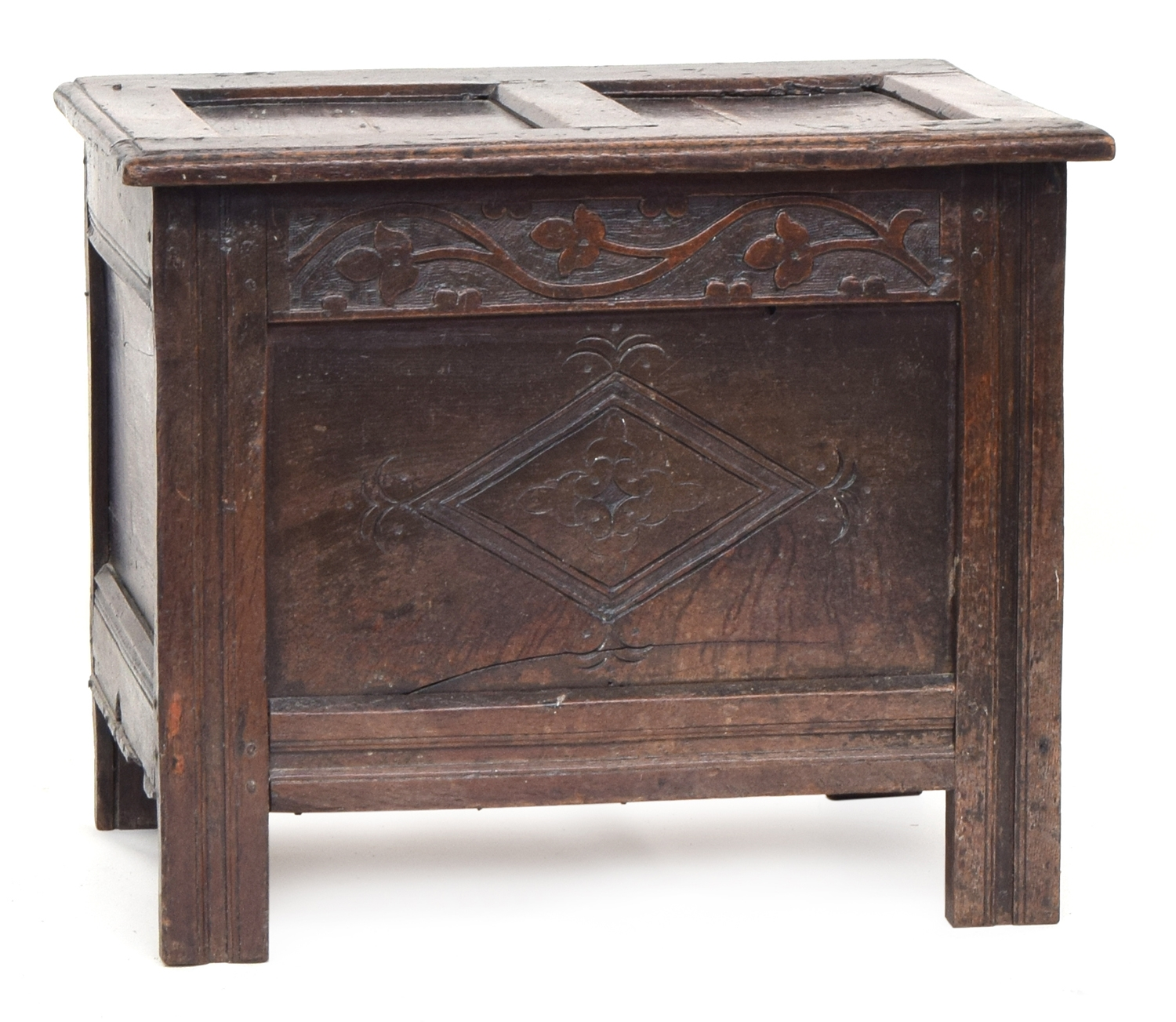 A single panel oak coffer, two panel hinged top, over blind fretwork and central lozenge, 69cm wide,