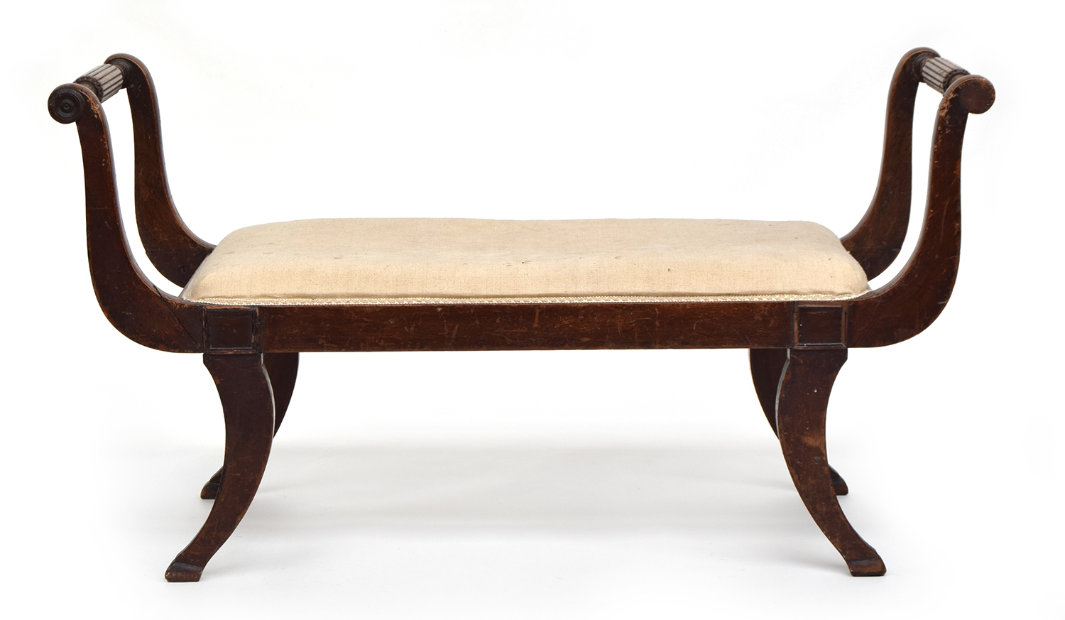 A large Regency upholstered duet stool, the reeded arms on swept supports, 117cm wide