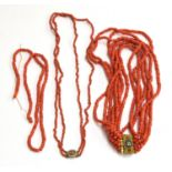 Two coral necklaces, one multi strand with ornate yellow metal and mosaic clasp, the other with a