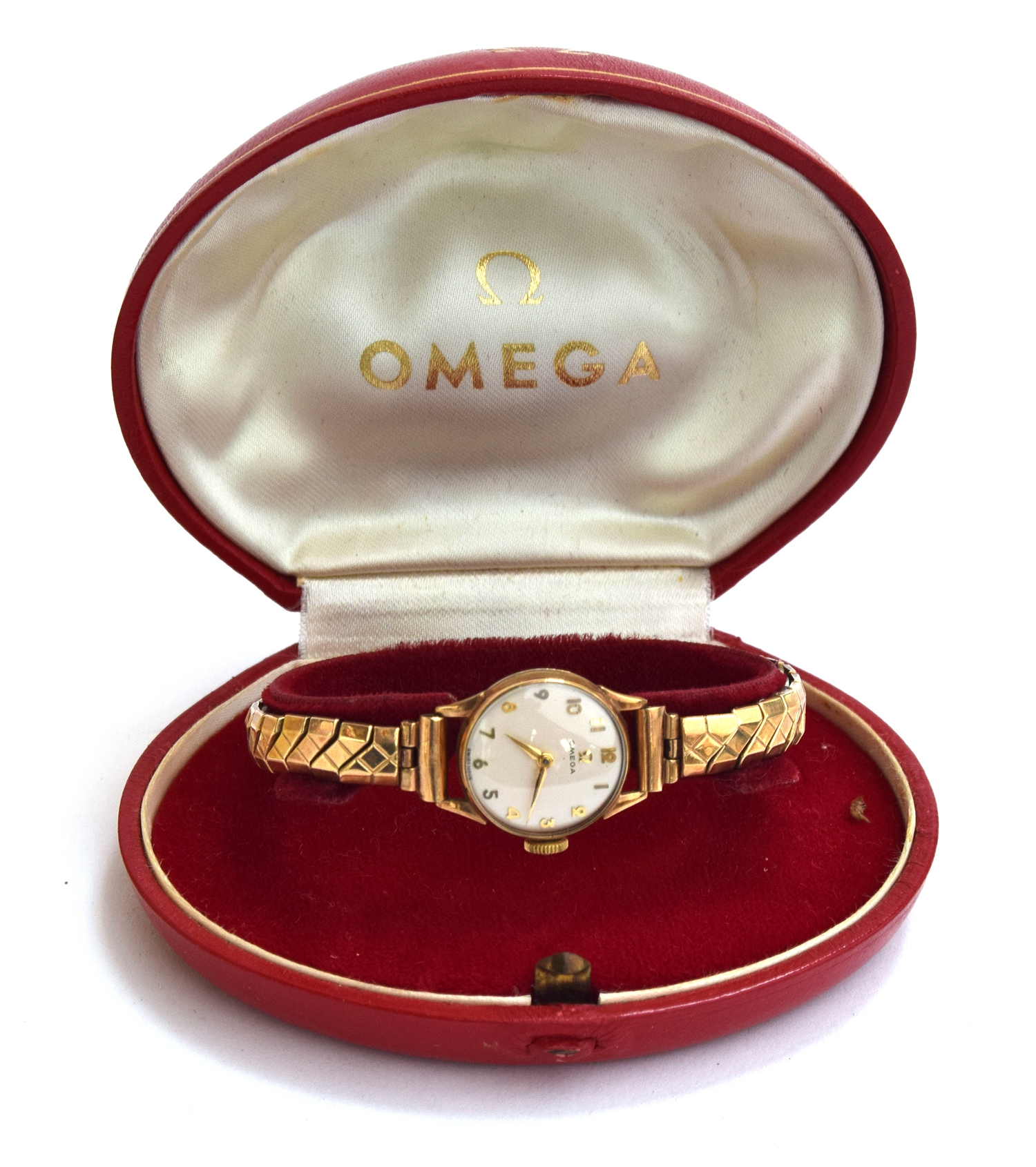 A ladies gold Omega watch on yellow metal bracelet. In original box and with paperwork