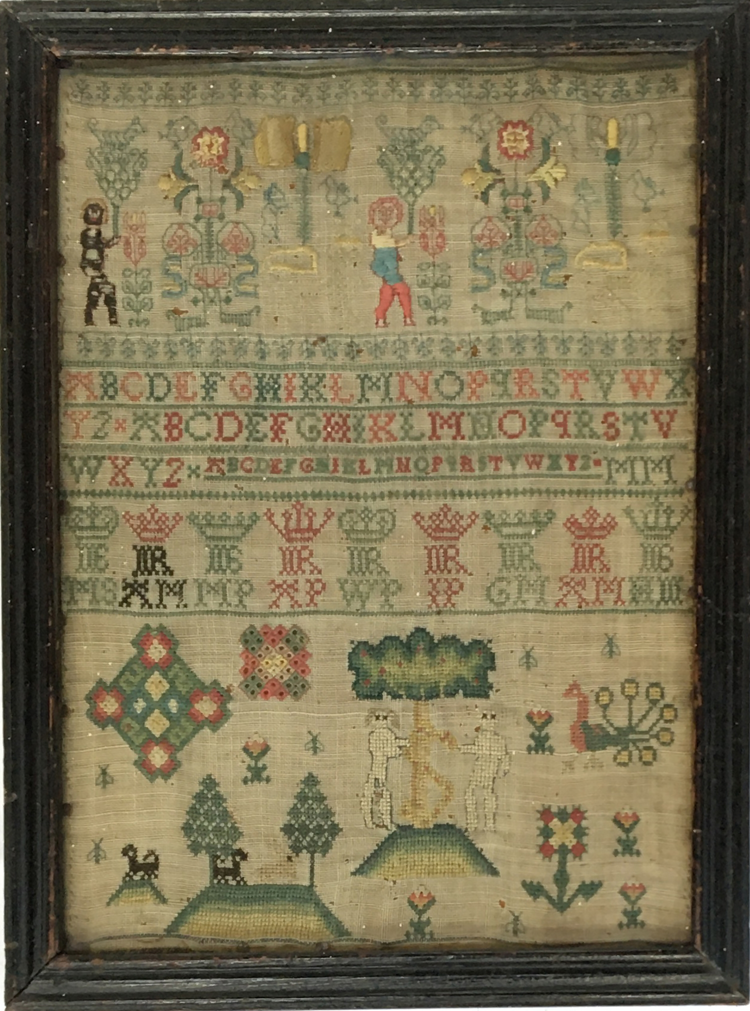 An early alphabet sampler, also worked with trees, animals, and figures, 30.5 x 22cm - Image 2 of 2