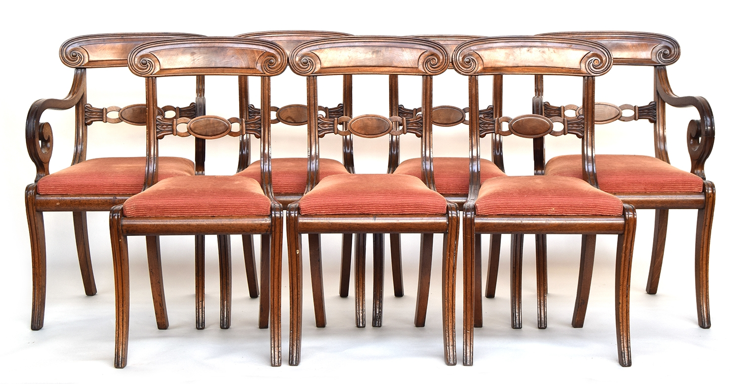 A set of seven Regency mahogany dining chairs with scroll carved rails, drop in seats, on sabre legs - Image 2 of 2