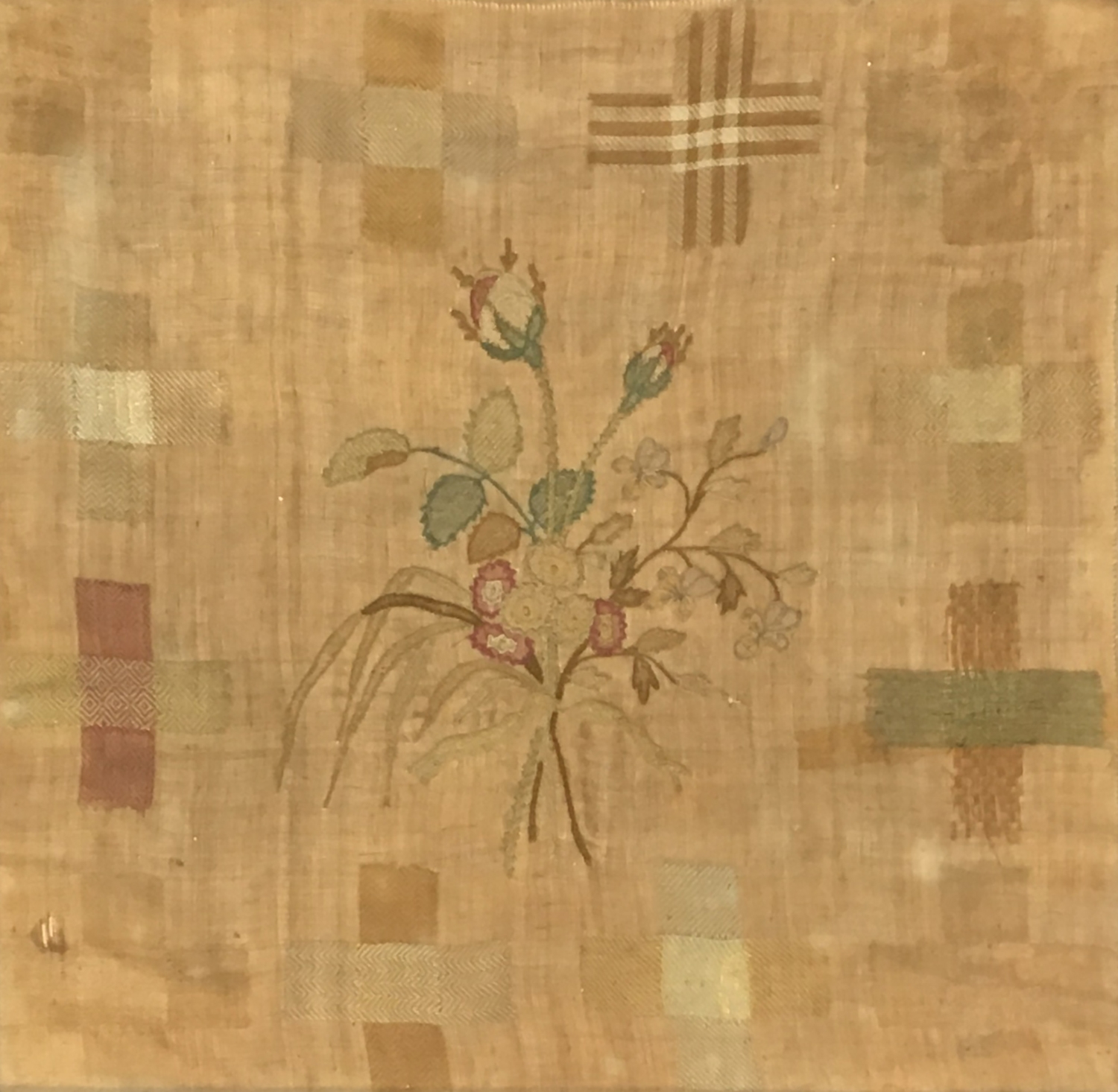 An 18th century needlework sampler depicting a stand of flowers, 33 x 34cm