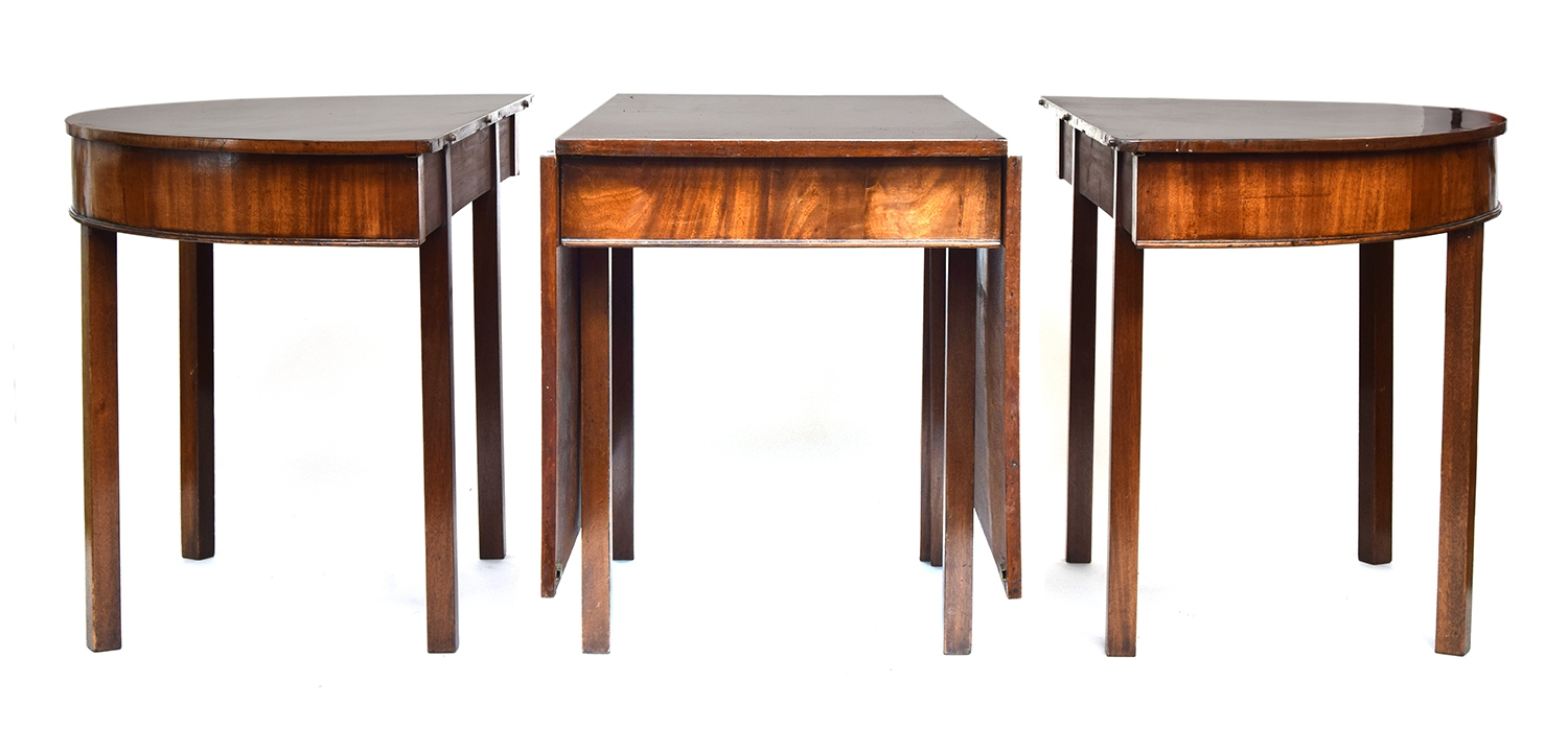 A large Regency mahogany and crossbanded dining table, with twin D-ends and drop leaf central