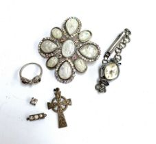 A 925 silver Celtic cross pedant; together with a 925 silver ring with bow design set with white